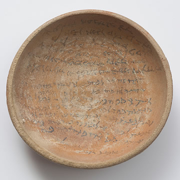 Shallow ceramic bowl with writing painted inside