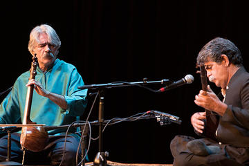 Kayhan Kalhor and Ali Akbar Moradi performing on stage