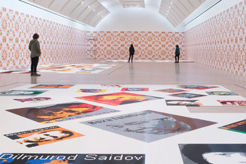 Wide shot of Ai Weiwei: Trace gallery with a few people in it