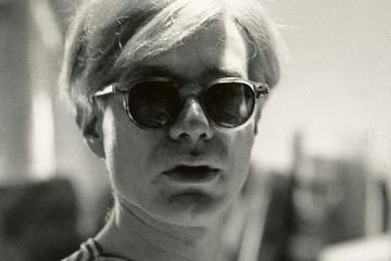 Andy Warhol wearing sunglasses