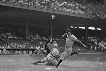 vintage photo of a baseball player hitting a home run