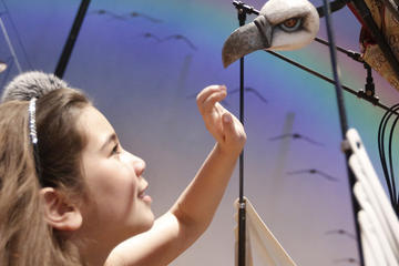 girl with puppet at interactive story telling