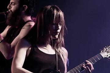 Keren Ann playing guitar