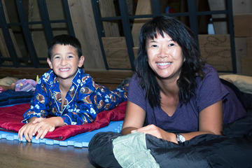 Here, families hear a bedtime story before retiring for the night.