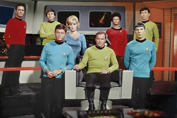 Star Trek group photo on the bridge