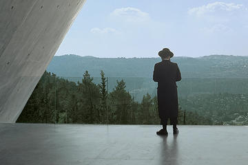 Hasidic Jew and a man and woman holding each other at Yad Vashem