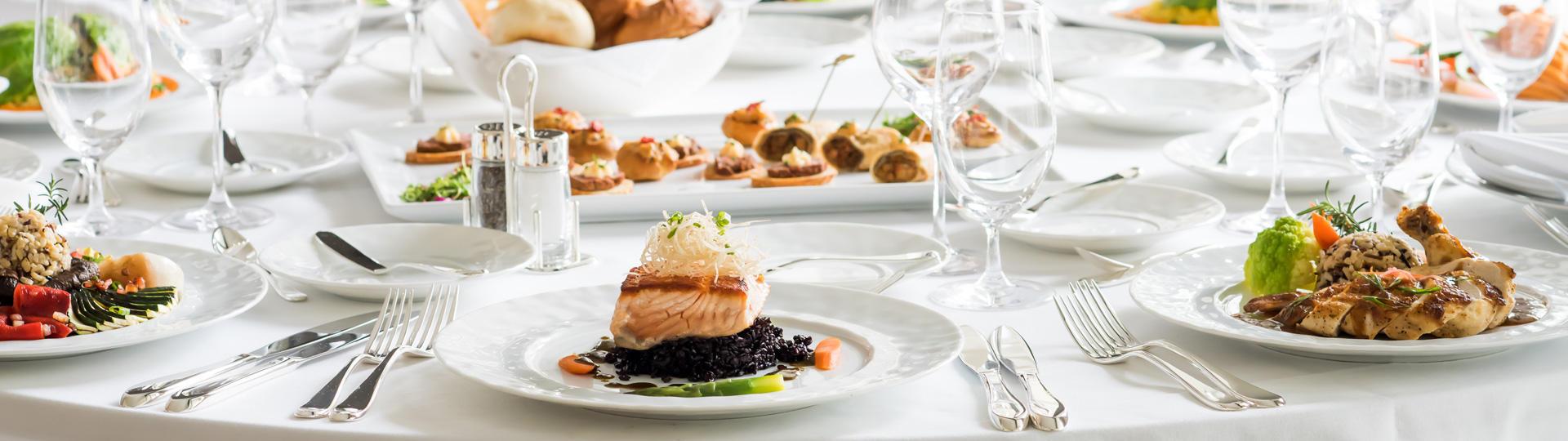 Food on plates, table settings