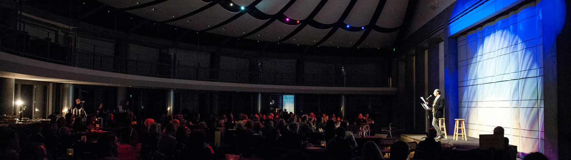People enjoying a comedy show at Skirball Cultural Center.