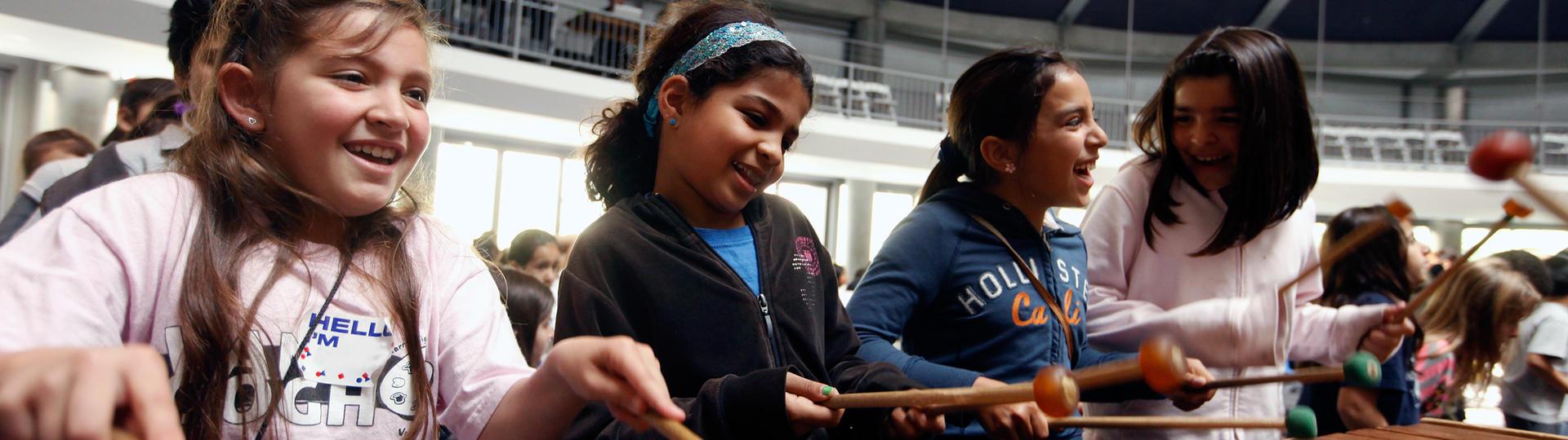 Young girls playing marimba