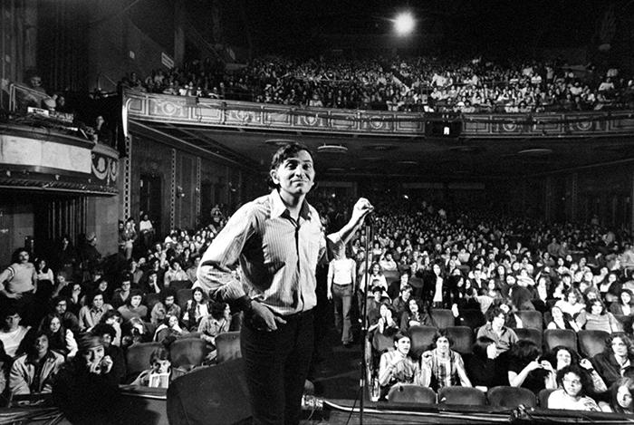 bill graham on stage in front of a large crowd
