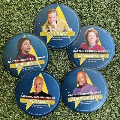 Five circular stickers in a circle featuring Star Trek captains Kirk, Janeway, Sisko, Picard, and Burnham